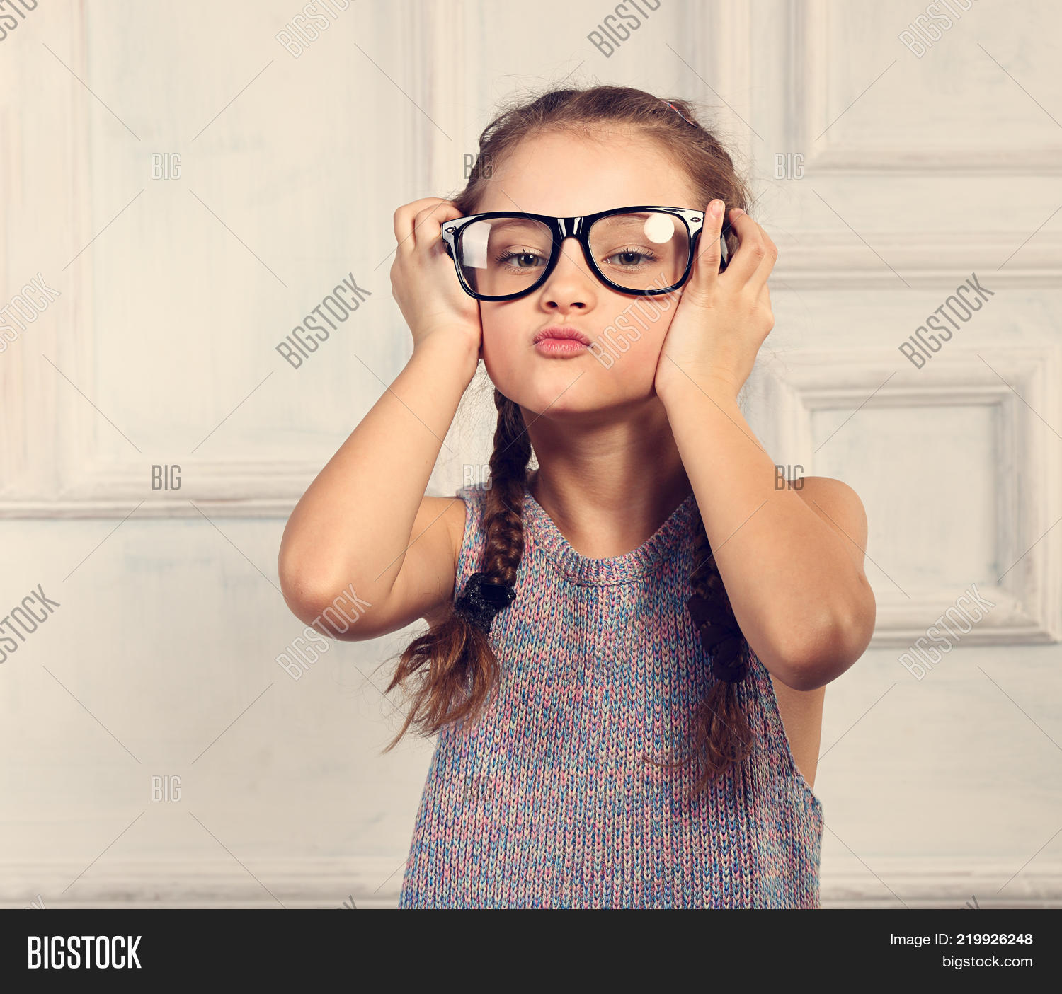 8a92ef2ee7 Happy Positive Thinking Kid Girl In Fashion Glasses With Excited Emotional  Face Looking Up On Studio