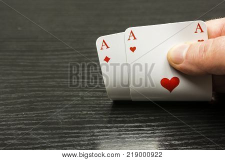 Good handing out the playing cards - you have two aces. We're playing next.