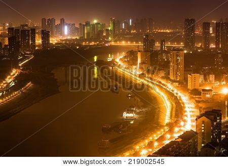 Aerial night view cityscape of Han river between Hankou and Hanyang districts in Wuhan central China