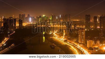 Aerial night view panorama of Han river between Hankou and Hanyang districts in Wuhan central China