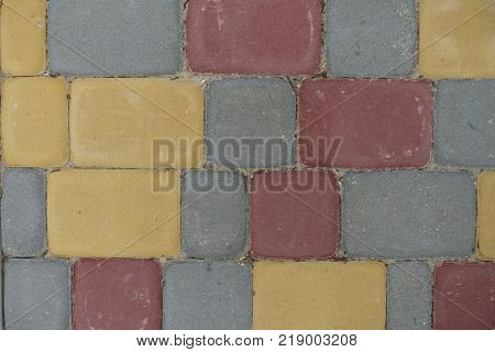 Colorful rectangular concrete pavement blocks from above