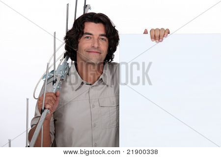 man holding a fence