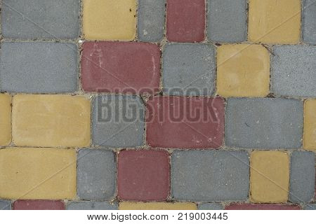 Multicolored rectangular concrete pavement blocks from above