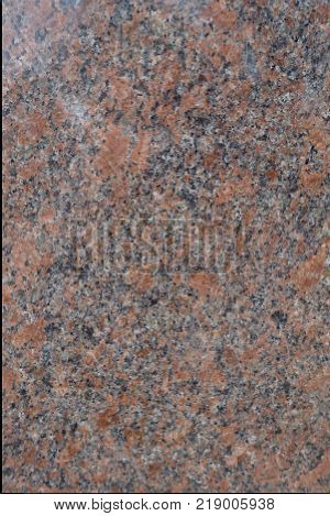 Texture of polished pink and grey granite stone