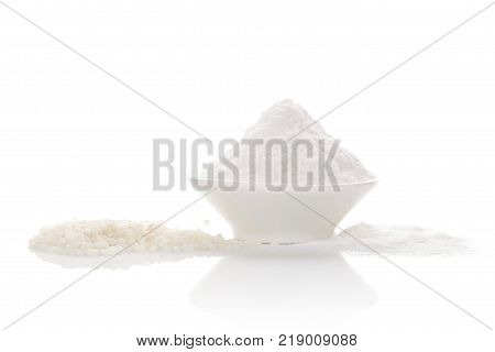 White rice with rice flour in bowl isolated on white background. Gluten free flour.