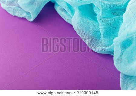 Purple background with colored gauze fabric violet color. Colorful fashion cloth texture background with copy space