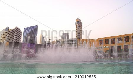 DUBAI, UNITED ARAB EMIRATES - MARCH 31st, 2014: The Dubai Fountain is the world's tallest performing fountain in Downtown Dubai next to gigantic mall. The popular musical fountain of Dubai are one of the most visited attractions of the arab city.