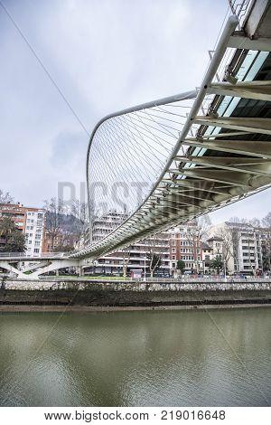 BILBAO-MARCH 21 2015: Zubizuri Bridge, Santiago Calatrava in Bilbao, Spain, on March 21, 2015. It is an arch bridge over the river Nervin