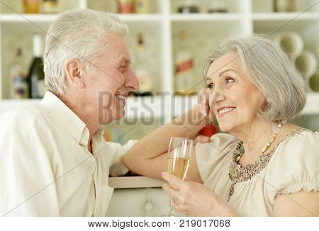 Portrait of mature couple drinking champagne, close up