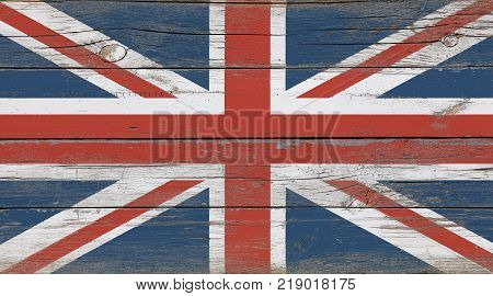 Old vintage UK British flag over white wood