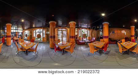GRODNO BELARUS - MARCH 15 2016: Panorama in interior modern youth fast food cafe. Full spherical 360 by 180 degrees seamless panorama in equirectangular equidistant projection. VR content