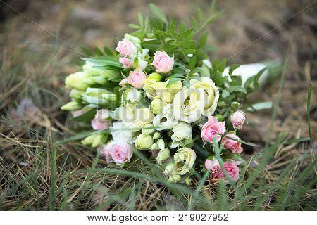 Bridal bouquet. A bouquet of the bride on the grass. The bride's bouquet