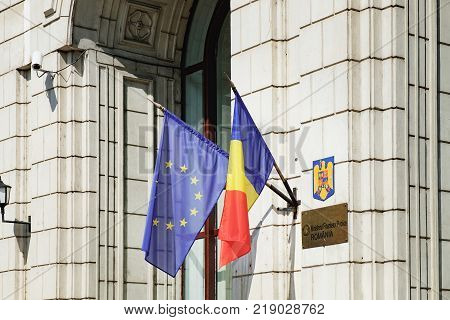 Bucharest, Romania - September 9, 2017: European Union and Romania flags on the wall of the building of Ministry of Regional Development and Public Administration in Bucharest, Romania.