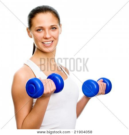 Portrait of fitness woman working out with free weights in gym