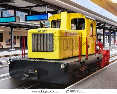 Engelberg, Switzerland - 12 October, 2015: a locomotive of the Zentralbahn railway company at a platform of the Engelberg railway station. The Zentralbahn is a Swiss railway company that owns and operates two railway lines in central Switzerland.