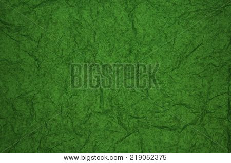 ABSTRACT RANDOM BACKGROUND OF CREASED CRUMPLED GREEN TISSUE PAPER