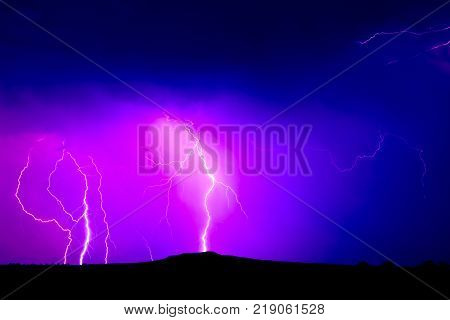 An early June lightning storm over Arlington Mesa in Arizona. Arizona's Monsoon storm season officially starts June 15th and lasts until the end of September.