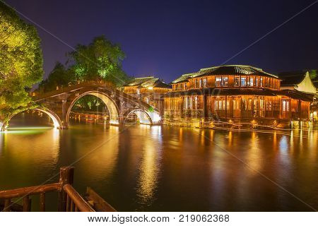 Wuzhen water village is Shanghai tourist attraction with more than 100000 visitors per year. Wuzhen is part of Tongxiang northern Zhejiang Province China.