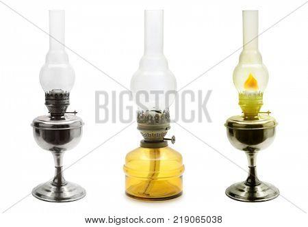 Set old vintage kerosene lamps isolated on white background