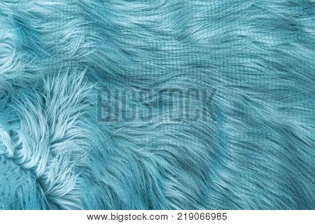 Blue artificial fur backgroung, top view.