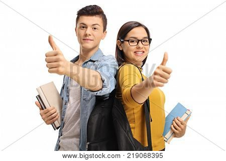 Teenage students with backpacks and books making thumb up gestures isolated on white background