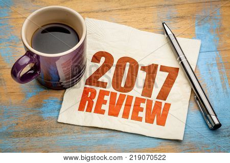 2017 review text on a napkin with a cup of coffee