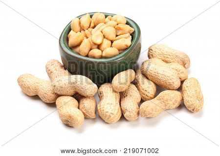 Roasted peanuts with peanut shells isolated on white background