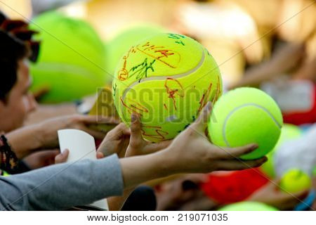 BARCELONA, SPAIN - APRIL, 22: Tennis fans hold a ball asking for an autograph to the players during a Barcelona tennis tournament Conde de Godo on April 22, 2015 in Barcelona Spain