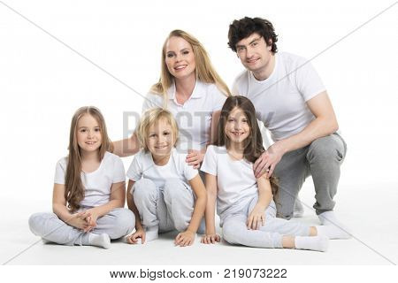 Five member family, parents and three children isolated on white background