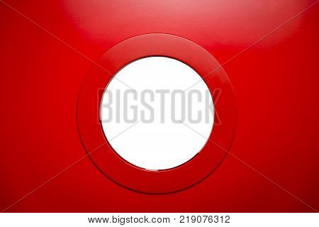 round white porthole in the red door. Сopy space