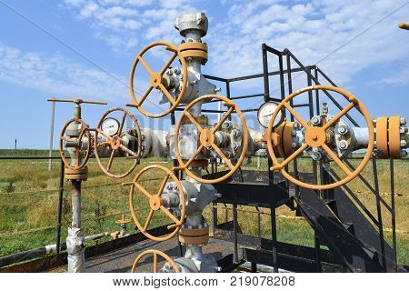 Wells in the Kuban. Extraction of hydrocarbons. Well for oil and gas production. Oil well wellhead equipment. Oil production.