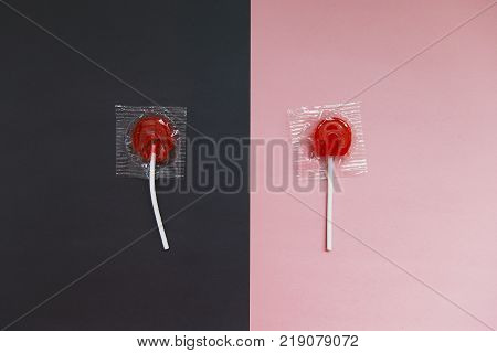 broken red lollipop on a black background and a beautiful whole lollipop on a pink background. The concept of life before and after psychotherapy