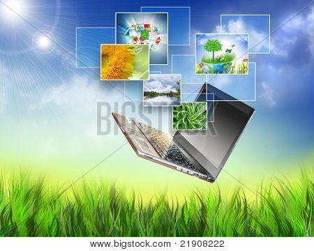 Мультимедийная концепция с современным ноутбуком на зеленом поле. Лучший Интернет концепции глобального бизнеса от