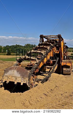 An antique trencher for digging trenches deep into the ground.