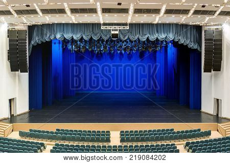Interior Of A White Conference Concert Hall Or Theatre With Blue Scene And Green Seats