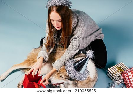 girl with a big dog parses gifts