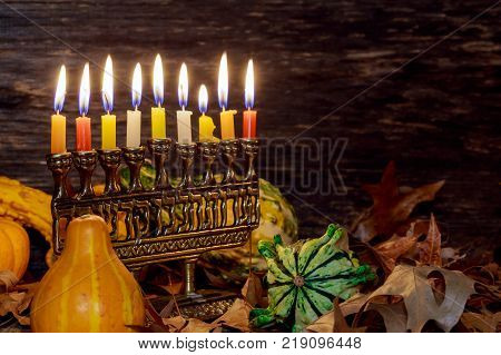 Jewish holiday hannukah symbols menorah. Copy space background.