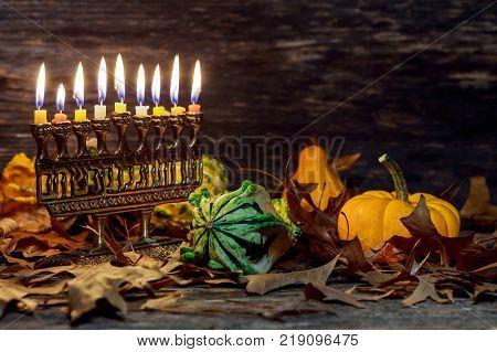 Hanuka menorah with burning candles. Jewish holiday hannukah