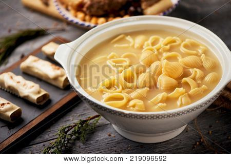 canelons, sopa de galets or escudella de Nadal, and carn dolla, cannelloni, soup with galets pasta and the meat and vegetables used in the broth, typically eaten on Christmas in Catalonia, Spain