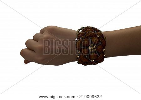 Brown bracelet mockup on a man's hand. Empty layout of the design of wrist banners. Cheap bracelets isolated. Bracelet from beads.
