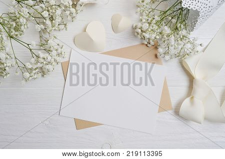 mockup Letter with a calligraphic pen greeting card for St. Valentine's Day in rustic style with place for your text, Flat lay, top view photo mock up.