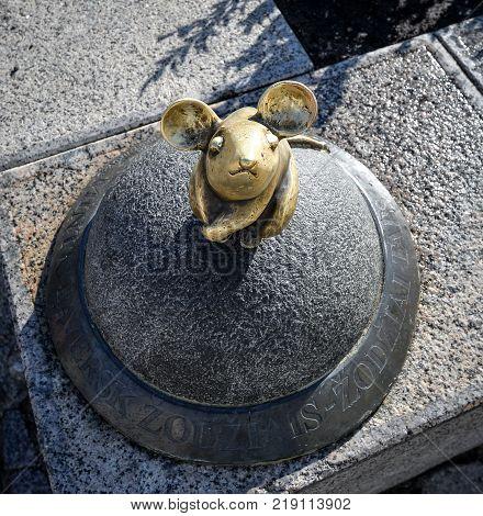 Klaipeda, Lithuania - August 16, 2017: Beautiful little magic mouse, Klaipeda, Lithuania. One of Klaipeda's charming, small street sculptures Golden Mouse