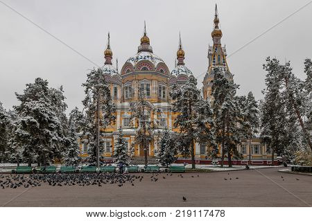 ALMATY, KAZAKHSTAN - OCTOBER 28, 2014: Pigeons at the Ascension Orthodox Cathedral