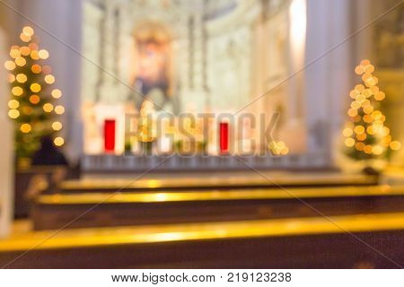 Defocused church interior blur abstract background with Christmas trees