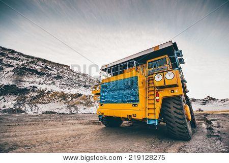 Big trucks working in an open pit. Coal mine. Mining
