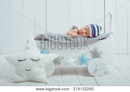 innocent little infant baby lying in wooden baby cot poster