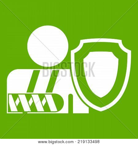 Broken arm and safety shield icon white isolated on green background. Vector illustration
