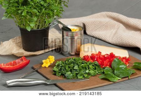 Sliced Vegetables. Cooking Process Of Cheese And Vegetables Muffins With Pepper, Spinach, Sweetcorn, Mature Gouda