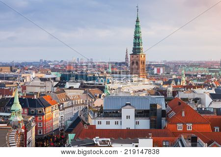 Cityscape of Copenhagen with spire of City Hall Denmark. Photo taken from The Round Tower popular old city landmark and viewpoint