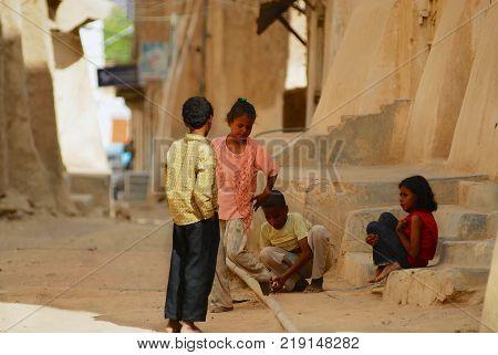 SHIBAM, YEMEN - SEPTEMBER 12, 2006: Unidentified kids play at the street in Shibam, Yemen.